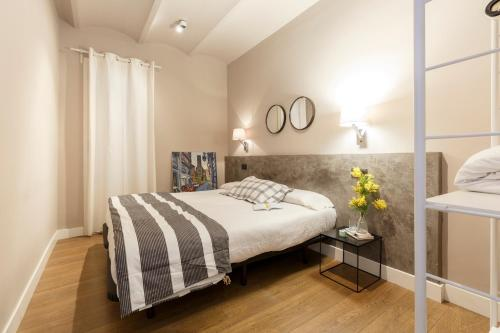 A bed or beds in a room at AinB Eixample-Miro Apartments