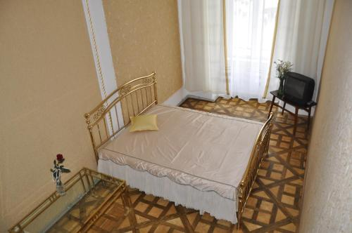A bed or beds in a room at Relax Apartments