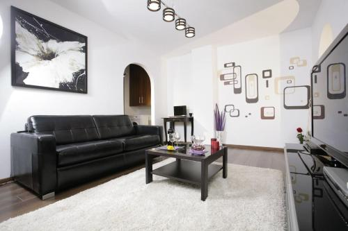A seating area at Lux Apartments
