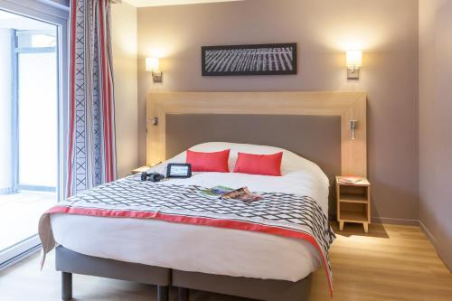 Ein Bett oder Betten in einem Zimmer der Unterkunft Résidence Pierre & Vacances La Petite Venise