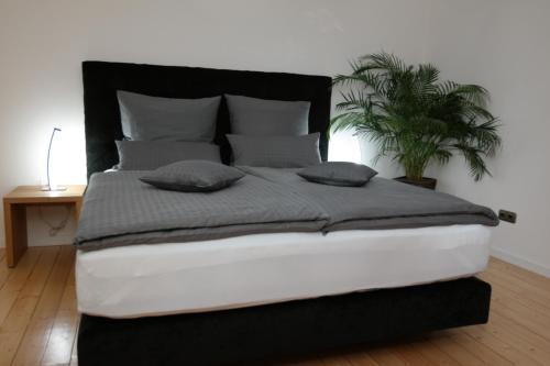 Кровать или кровати в номере Pension Franzbäcker