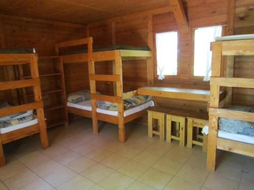 A bunk bed or bunk beds in a room at Sóstói Lovaskemping és Turistaház
