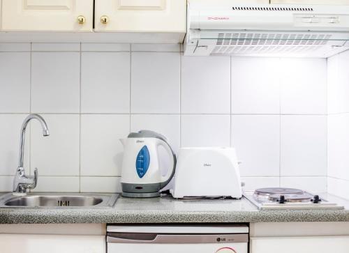 Una cocina o zona de cocina en MR Apart Providencia (ex Apart Neruda)