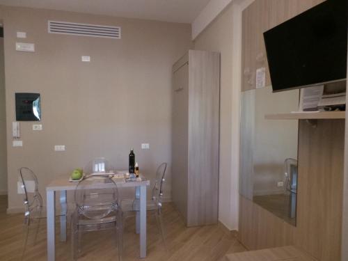TV o dispositivi per l'intrattenimento presso Marbia Guest House