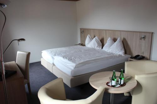 Ein Bett oder Betten in einem Zimmer der Unterkunft Martinshof