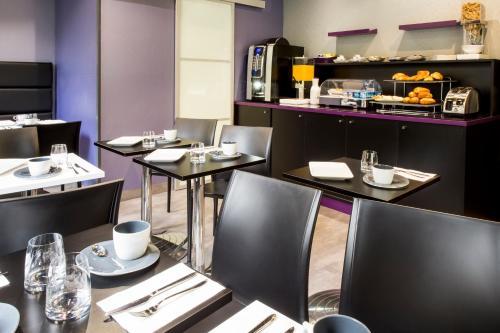 Restaurant ou autre lieu de restauration dans l'établissement Hotel des Savoies Lyon Perrache