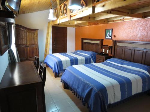 A bed or beds in a room at Hotel Ecológico Temazcal