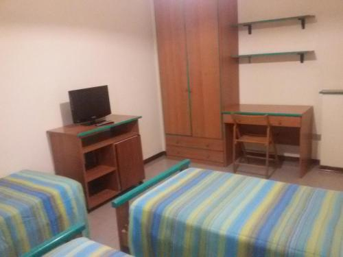 Телевизор и/или развлекательный центр в Hotel Fiera