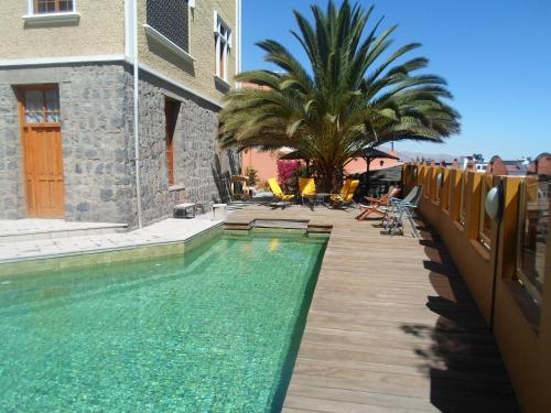 The swimming pool at or near Posada El Castillo