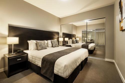 A bed or beds in a room at Quest Bundoora
