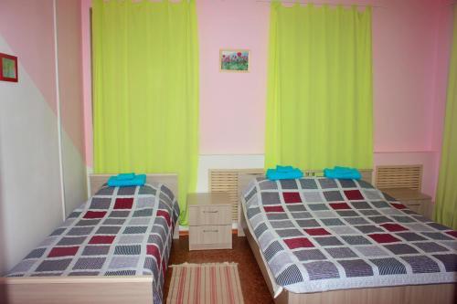 Кровать или кровати в номере Гостевой дом Берёза