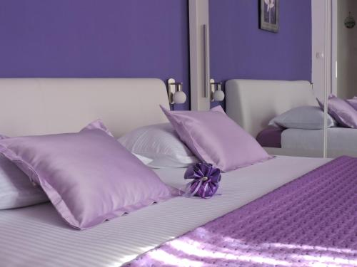 A bed or beds in a room at Apartments & Rooms Trogir Stars