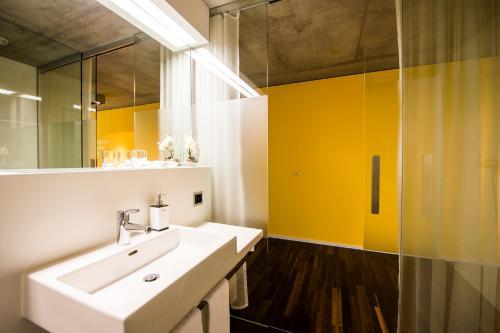 A bathroom at HOTEL APART - Welcoming l Urban Feel l Design