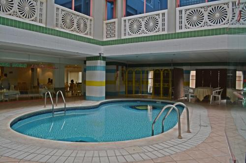 The swimming pool at or near Queens Hotel