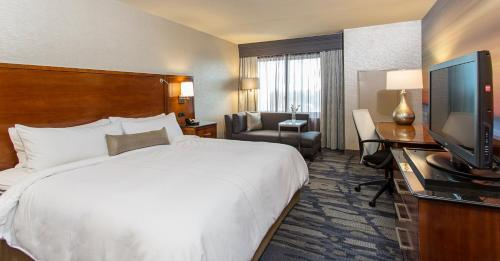 A bed or beds in a room at Rochester Airport Marriott