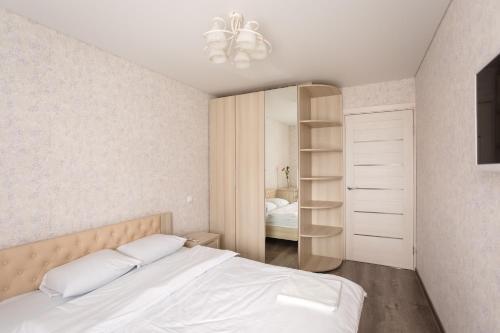 Кровать или кровати в номере Хочу Приехать На Мальцева