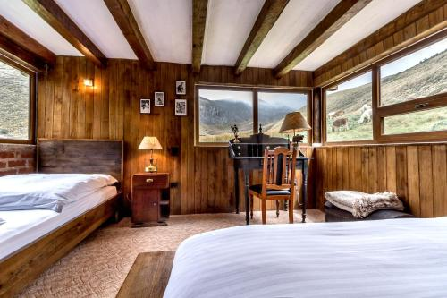 A bed or beds in a room at Chimborazo Lodge