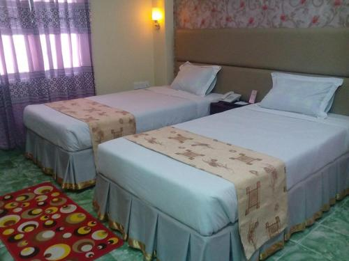 A bed or beds in a room at Golden Inn Chattagram Ltd