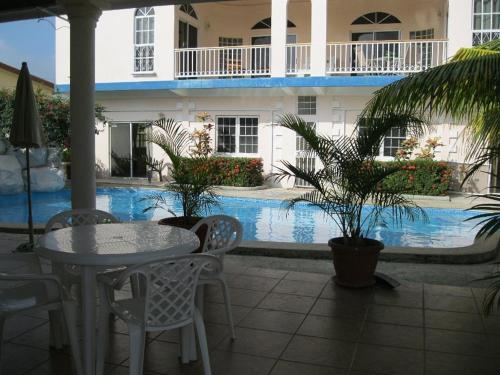 The swimming pool at or near Villa San Juan