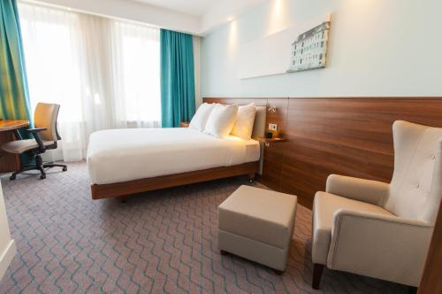 A bed or beds in a room at Hampton by Hilton Amsterdam Centre East