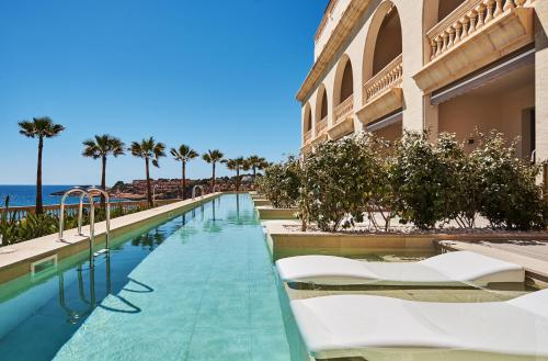 The swimming pool at or near Pure Salt Port Adriano - Adults Only
