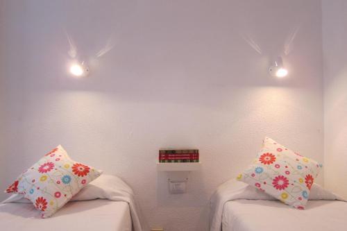 Cama o camas de una habitación en Canteras Beach Promenade