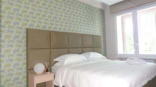 A bed or beds in a room at Augustana House and Suites