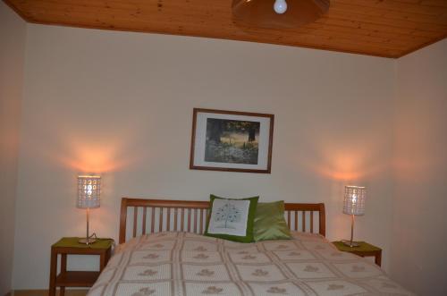 Ein Bett oder Betten in einem Zimmer der Unterkunft Ferienwohnung Grössenberg