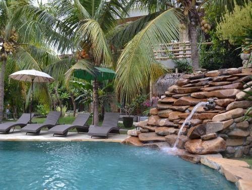 The swimming pool at or near Ganesh Lodge