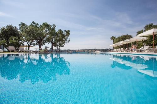 The swimming pool at or near Hotel Spiaggia d'Oro - Charme & Boutique