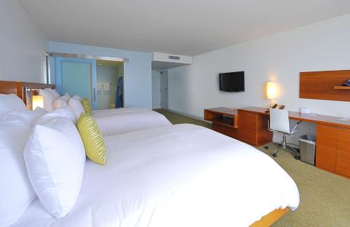 A bed or beds in a room at Tower 23 Hotel