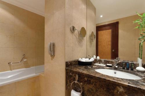 A bathroom at Wyndham Grand Regency Doha
