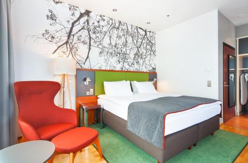 A bed or beds in a room at Holiday Inn Helsinki City Centre