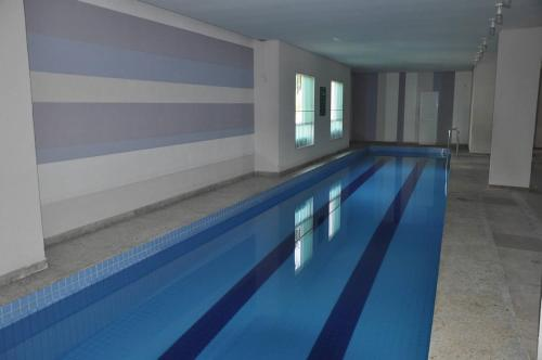 The swimming pool at or near Riviera Park - Flat Residencial