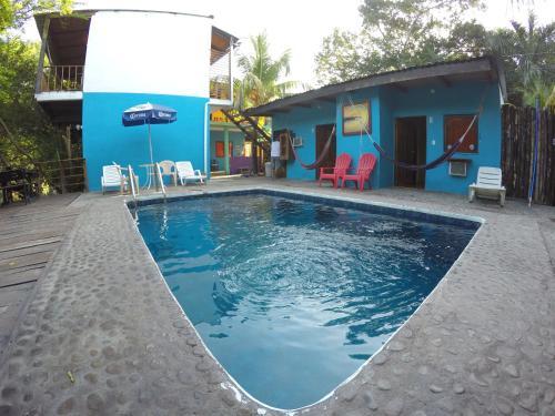 The swimming pool at or near Posada Luna
