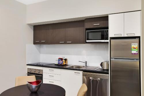 A kitchen or kitchenette at Quest Maitland