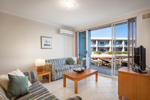 A seating area at C Mandurah Resort & Serviced Apartments