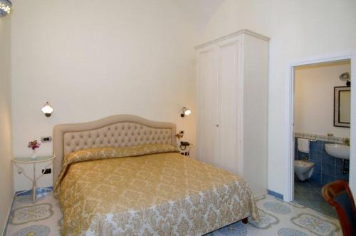 Letto o letti in una camera di B&B Palazzo Pisani