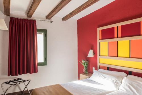 Cama o camas de una habitación en Apartaments Ciutat Vella