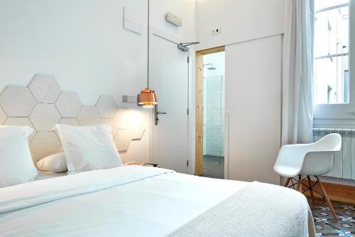 Cama o camas de una habitación en La Casa de Antonio Boutique Rooms