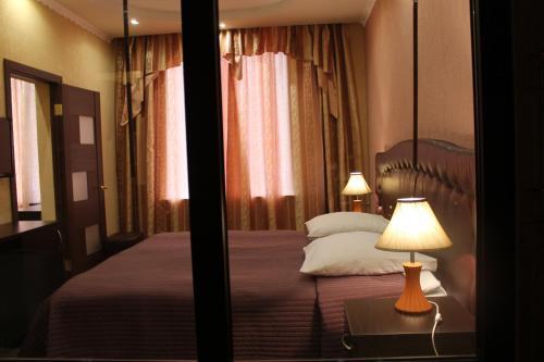 Кровать или кровати в номере Гостиница Металлург