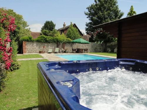 The swimming pool at or near The Old Priory B&B