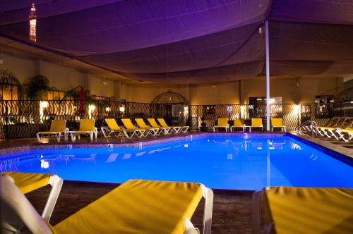 The swimming pool at or near Jockey Club Suites