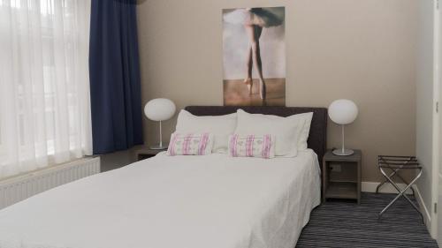 Een bed of bedden in een kamer bij B&B House No 7