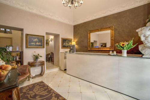 Лобби или стойка регистрации в Hotel Caravaggio