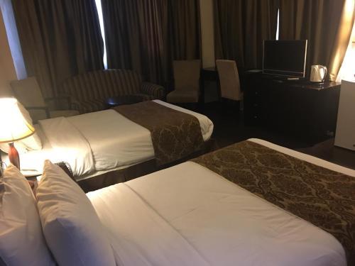 Cama o camas de una habitación en Shepherd Hotel
