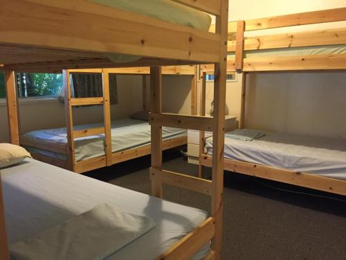 A bunk bed or bunk beds in a room at Sandy Court Holiday Units