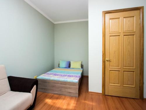A bed or beds in a room at ApartLux Park Pobedy 2