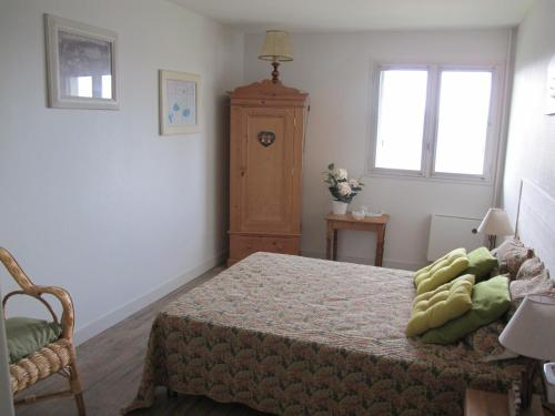 A bed or beds in a room at Residence Saint Michel