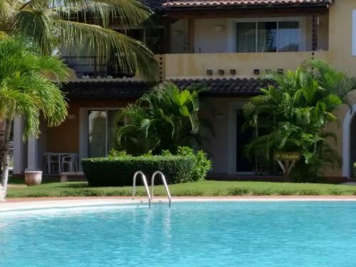 The swimming pool at or near Tamarindo Pilar 57
